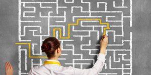 woman solving maze