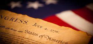 United States Declaration of Independence on flag background