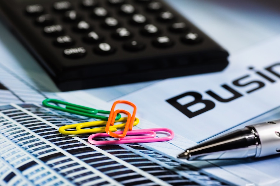 calculator calculating business expenses